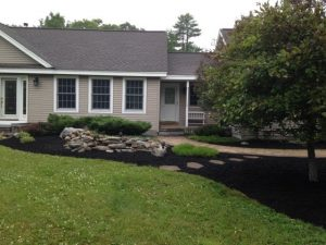 Photo of well mulched garden in a South Portland community
