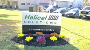 Photo of Helical Solutions with a nice mowed lawn
