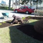 photo of justin mulching a lawn in a hoodie