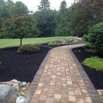photo of finished landscaping around a brick path