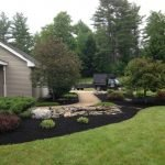 photo of well maintained lawn with the ac yard services truck in the back