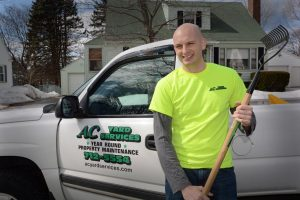 photo of owner justin with a rake