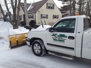Photo of AC Yard Services truck plowing a yard