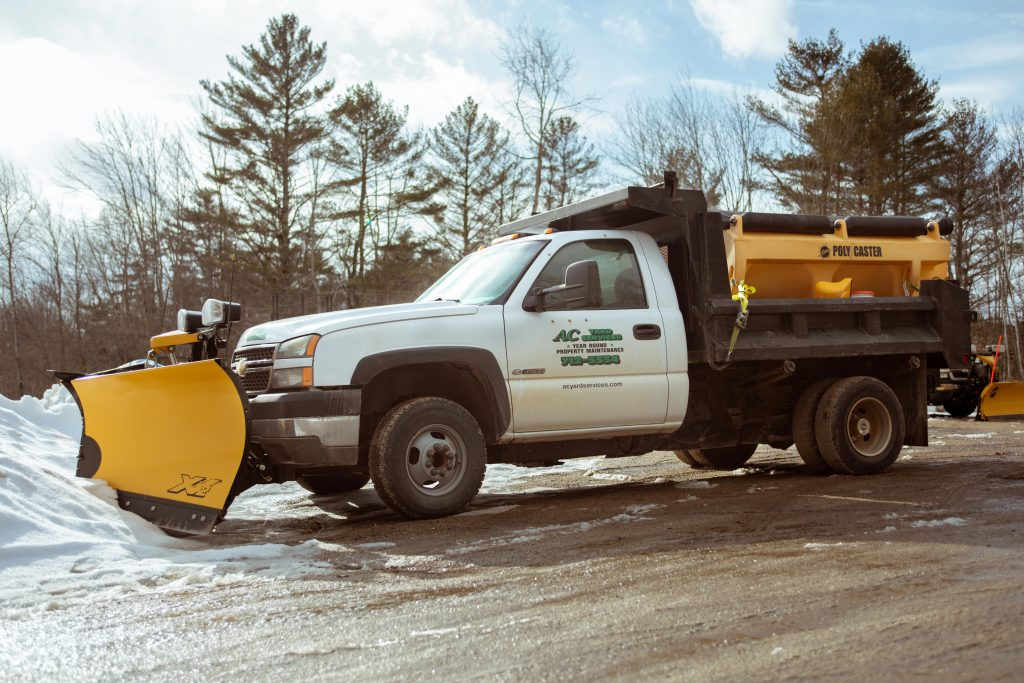 AC Yard Service plow truck fully equipped driving into the snow