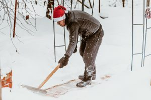 dude shoveling his yard